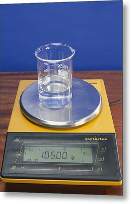 Salt Solution On Scales Metal Print