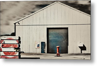 Shed With Bollard And Pallets Metal Print by Harry Neelam