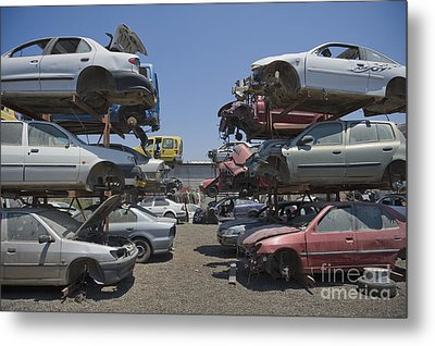 Shot Of Junkyard Cars Metal Print by Noam Armonn