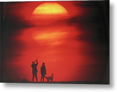 Silhouette Of Couple With Dog, Man Aiming, Sunset Metal Print by David De Lossy