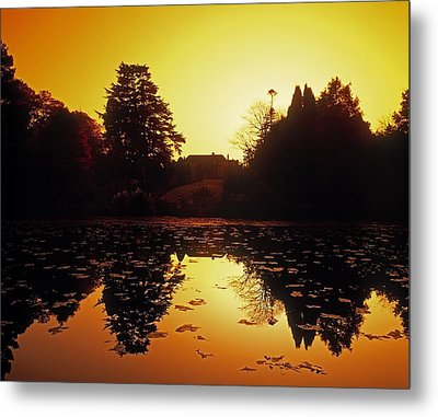 Silhouetted Home And Trees Near Water Metal Print by The Irish Image Collection