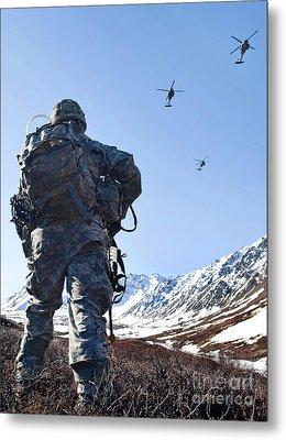 Soldier Patrols Through Alaska's Metal Print by Stocktrek Images