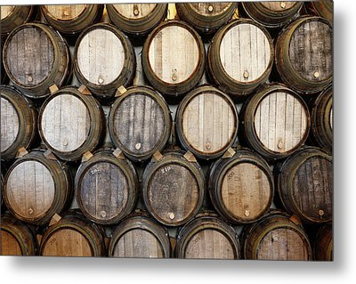 Stacked Oak Barrels In A Winery Metal Print by Marc Volk