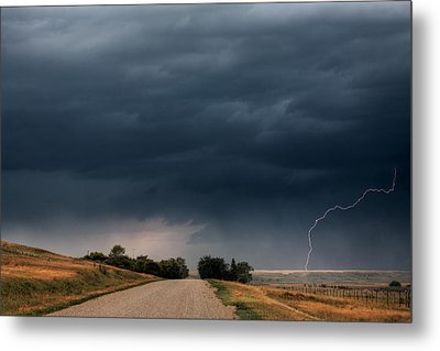Storm Clouds And Lightning Along A Saskatchewan Country Road Metal Print by Mark Duffy