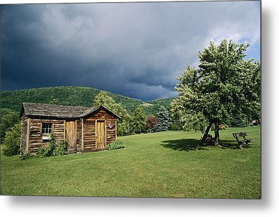 Storm Clouds Form Above A Log Cabin Metal Print by Raymond Gehman