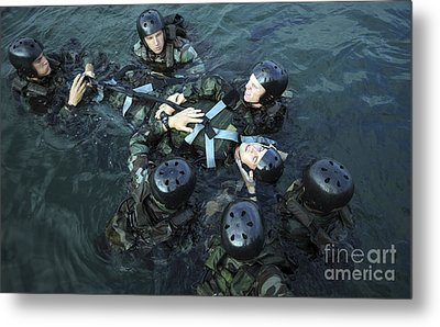 Students Secure A Simulated Casualty Metal Print by Stocktrek Images