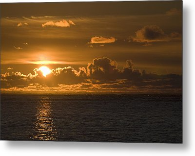 Sun Setting On The Ocean With The Metal Print by Michael Interisano