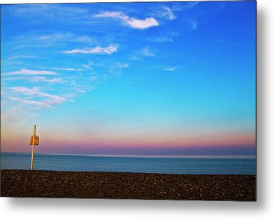 Sunset On Empty Beach With Lifebouy On Post Metal Print by Image by Catherine MacBride