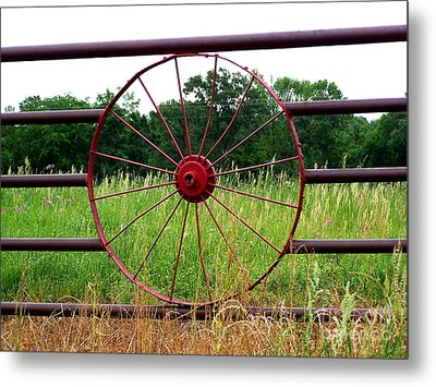 Metal Print featuring the photograph Texas Wildflowers Through Wagon Wheel by Kathy  White