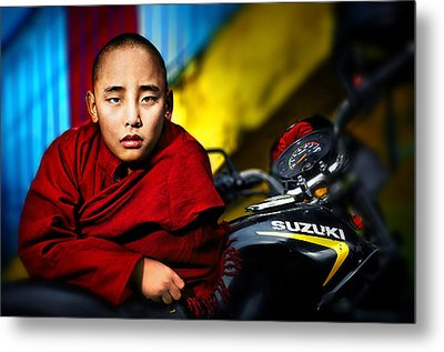 The Boy Monk In Red Robe Standing Beside A Motorcycle In A Buddh Metal Print by Max Drukpa