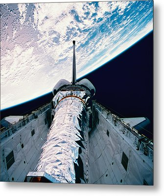 The Space Shuttle With Its Open Cargo Bay Orbiting Above The Earth Metal Print by Stockbyte