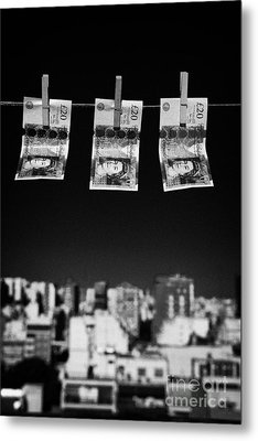 Three Twenty Pounds Sterling Banknotes Hanging On A Washing Line With Blue Sky Above A City Skyline Metal Print by Joe Fox