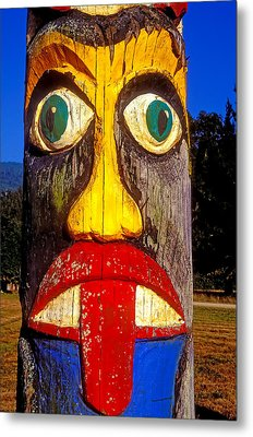 Totem Pole With Tongue Sticking Out Metal Print by Garry Gay