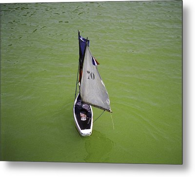 Toy Sailboat On Pond Metal Print by Donna Munro