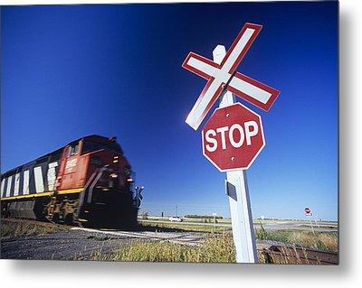 Train Passing Railway Crossing Metal Print by Dave Reede