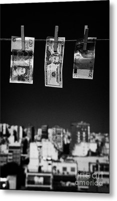 Twenty Pounds Dollars Euro Banknotes Hanging On A Washing Line With Blue Sky Over City Skyline Metal Print by Joe Fox