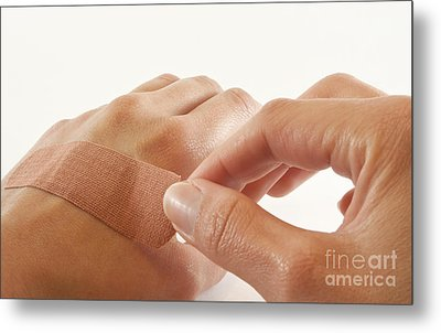 Two Hands With Bandage Metal Print by Blink Images