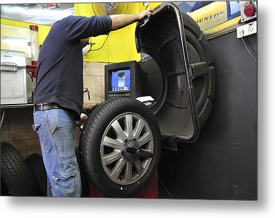 Tyre Workshop And Garage Metal Print by Photostock-israel