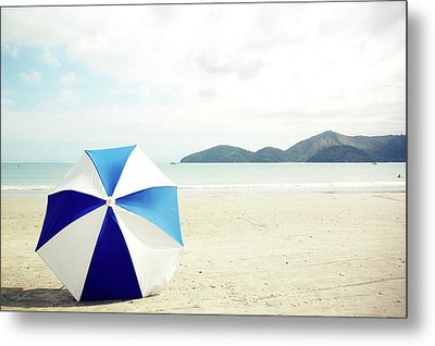 Umbrella On Sand Metal Print by Grace Oda
