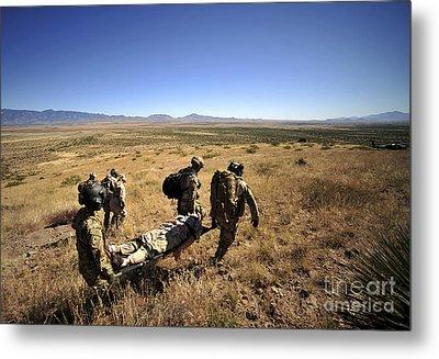 U.s. Air Force Pararescuemen Carry Metal Print by Stocktrek Images