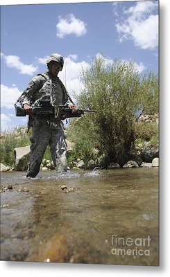 U.s. Army Soldier Crosses A Stream Metal Print