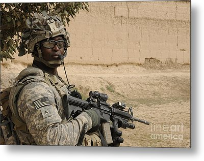 U.s. Army Soldier Scans His Area While Metal Print by Stocktrek Images