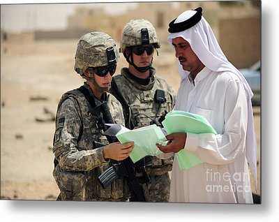 U.s. Army Soldiers Talking With A Town Metal Print by Stocktrek Images