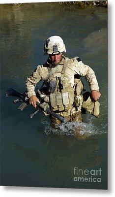 U.s. Marine Crosses A Stream Metal Print