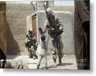 U.s. Marine Gives An Afghan Child Metal Print by Stocktrek Images