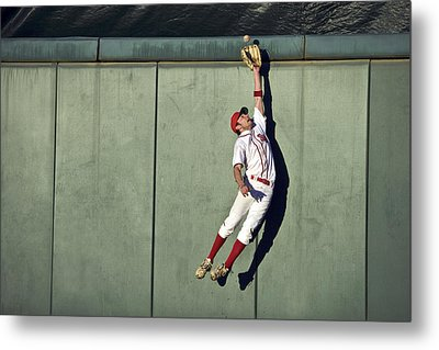 Usa, California, San Bernardino, Baseball Player Making Leaping Catch At Wall Metal Print by Donald Miralle