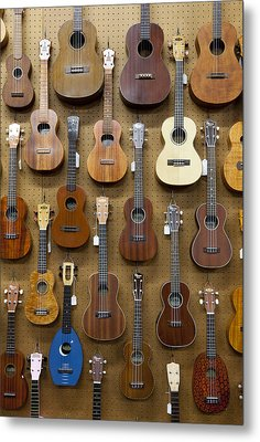 Various Guitars & Ukuleles Hanging From Wall Metal Print by Lisa Romerein