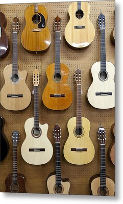 Various Guitars Hanging From Wall Metal Print by Lisa Romerein