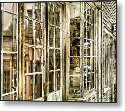 Vc Window Reflection Metal Print by Susan Kinney