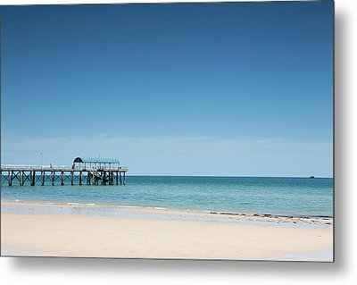 View Of A Pier From A Sandy Beach Metal Print by Caspar Benson