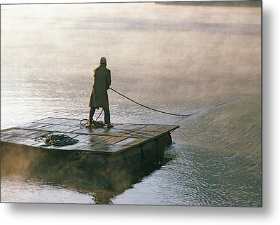 Villager On Raft Crosses Lake Phewa Tal Metal Print by Gordon Wiltsie