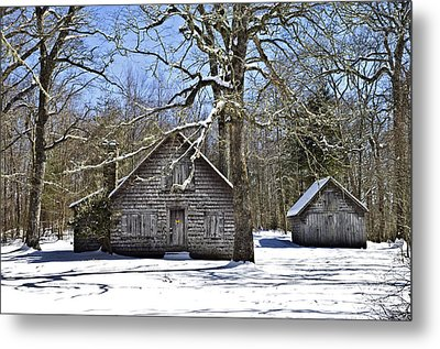 Vintage Buildings In The Winter Snow Metal Print by Susan Leggett