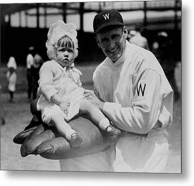 Metal Print featuring the photograph Walter Johnson Holding A Baby - C 1924 by International  Images