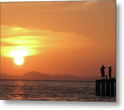 Watching A Sunset From The Jetty Metal Print by Thepurpledoor