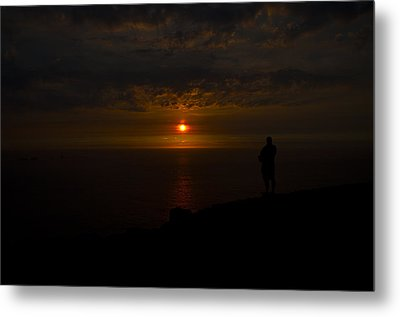 Watching The Sunset Metal Print by Paul Howarth