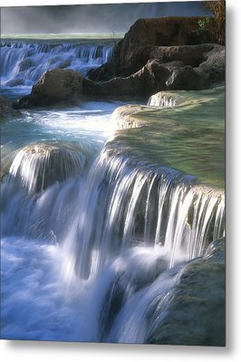 Water Flowes Over Travertine Formations Metal Print by Bill Hatcher