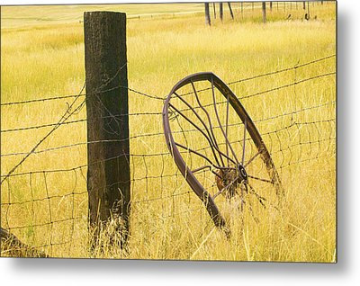 Wheel Looking For A Tractor Metal Print by Rich Franco