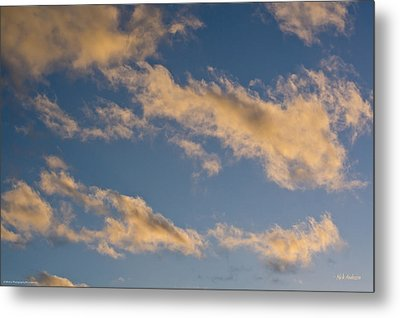 Wind Driven Clouds Metal Print by Mick Anderson