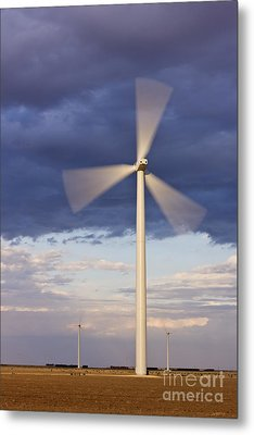 Wind Turbine Spinning At Dusk Metal Print by Jeremy Woodhouse