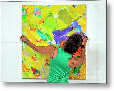 Woman Adjusting A Painting Metal Print by Sami Sarkis