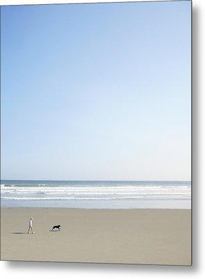 Woman And Dog On Beach Metal Print by Richard Newstead