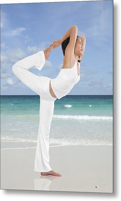 Woman Doing Yoga On The Beach Metal Print by Setsiri Silapasuwanchai