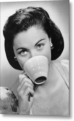 Woman Drinking From Cup Metal Print by George Marks