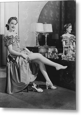 Woman Sitting At Vanity Table, Putting On Stockings, (b&w), Portrait Metal Print by George Marks