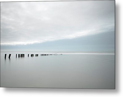 Wooden Stakes In Sea Metal Print by Amk