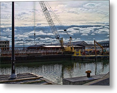 Working With Clouds Metal Print by Peter Chilelli